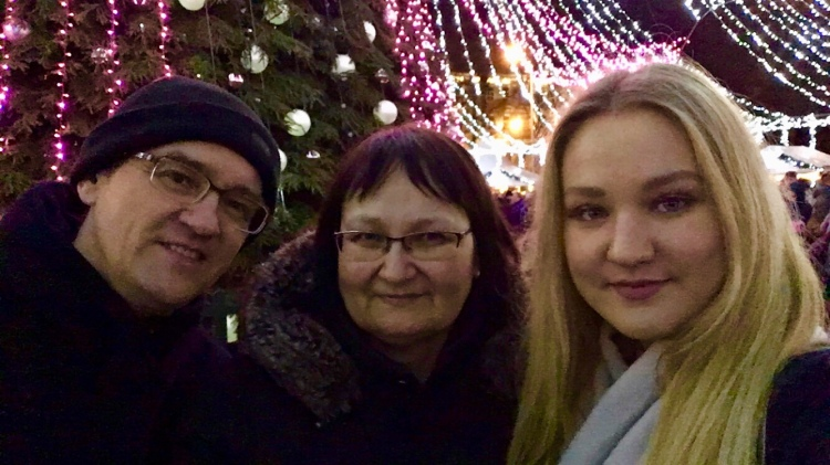 Dad, auntie and I by the tree